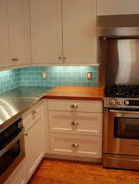 under counter lighting kitchen. Kitchen Under Counter Lighting In White Cabinets And Blue Subway Tile Backsplash