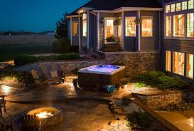 patio designs with fire pit and hot tub. Surrounded By A Natural Stone Wall, This Hot Tub Installation Incorporates Raised Patio. The Backyard Spa Overlooks Separate Seating Area And Fire Patio Designs With Pit