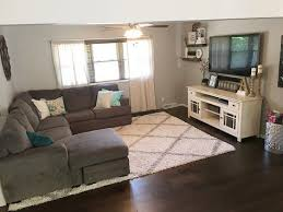 tv rooms furniture. open concept gray sectional floating shelves farmhouse living room modern hardwood floors white tv console rug rooms furniture