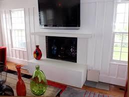 custom white concrete fireplace surround and mantel