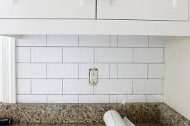 do you love the look of white subway tile but can t commit to