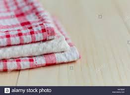 Stack Of Kitchen Towels On Light Wooden Background Stock