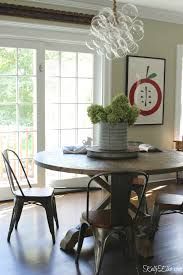 wow love the modern bubble chandelier paired with farmhouse kitchen table kellyelko com