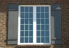 Building Exterior Shutters Exterior Window Shutters With Decorative Cutouts Harking Back To