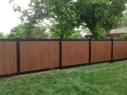 amazing twotone black and rosewood pvc illusions vinyl fence installed by king of westchester ny black rosewood grand illusions illusions vinyl fence dealers c0