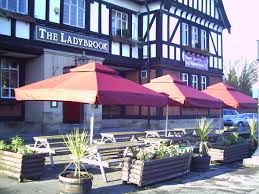 metre giant umbrella:   metre burgundy parasols on site at the ladybrook tavern in cheshire
