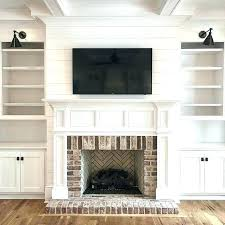 adding bookshelves around fireplace designs vaulted ceiling