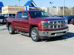 Used Chevrolet Silverado 1500 LTZ Z71 red exterior in Houston, TX
