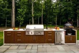 brown jordan outdoor kitchens johns outdoor space is the ideal patio for entertaining guests the center is defined by a large dining table this table can