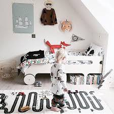 a simple rug transforms this bedroom into a kids fun play spot the rug by oyoy design is 100 cotton and really just the coolest