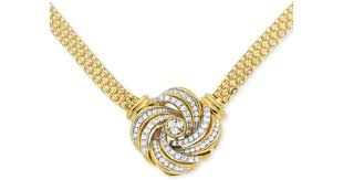 lyst macy s diamond love knot pendant necklace 1 2 ct t w in 14k gold plated sterling silver in metallic