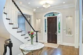 front door chandelier front door foyer designs entry traditional with light gray walls marble table top