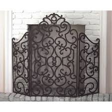 stained gold iron scroll design fireplace screen