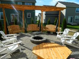 patio with fire pit and pergola. Fire Pit And Swings On Paver Patio With Pergola O