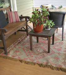 before we put it on the porch we had it in the studio over another synthetic rug we liked the look of it indoors too