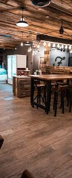 Here we did a reclaimed wood ceiling, bars, reclaimed wood tables, cafe tables, custom cabinets for the kitchen build out. Foxtail Coffee Co University Blvd Drive Thru
