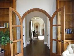 Arched doorway ideas spaces traditional with double doors double doors wood  flooring