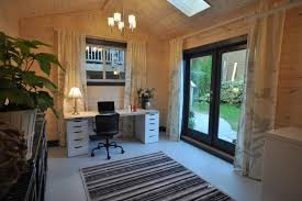home office in garage. light wood office with white desk home in garage