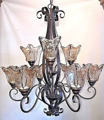9 light chandelier rubbed bronze with amber hand blown glass
