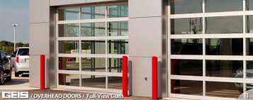 commercial overhead full view glass garage door from geis in milwaukeee