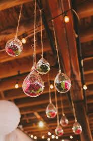 industrial rustic maine venue hanging glass orb terrariums