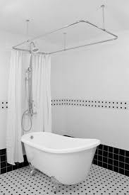 cute clawfoot tub shower conversion kit with black and white wall tiles using white curtain