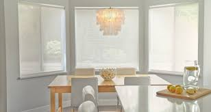 chic kitchen with gray walls paint color bay windows rectangular wood table west elm capiz chandelier white modern chairs and yellow accents