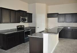 dark brown espresso kitchen cabinets with white island
