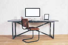 wooden chair front view. Front View Of Designer Desk With Empty Computer Display, Frames And Other Items Brown Wooden Chair
