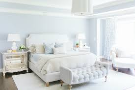 white and blue bedroom features tray ceiling accented with barbara barry simple scallop pendant over blue walls framing an ivory linen bed with nailhead