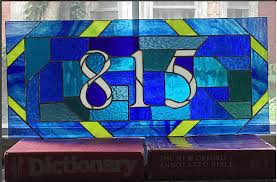 stained glass transom house number by nutmeg designs in blue and lime