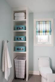 kids bathroom with tall shelving unit with rolling hamper