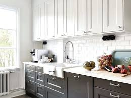 black and white countertops black and white kitchen with white top cabinets and black bottom cabinets paired with white and subway tile black granite