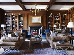 wood paneling and chesterfield sofas distinguish a refined room