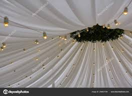 White Paper Flower Bulbs Decorated Tent With Bulb Garland Wedding Setup White Paper