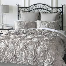 grey ruched duvet cover with metal headboard and