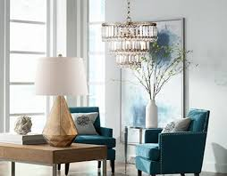 a chandelier and table lamp in a chic room