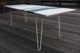 it is finished w two fresh coats of semi gloss paint over an oil based primer the legs are spray painted white the table measures 47 w x 17 1 2 d x 14