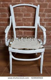 renovate old furniture. renovation of old furniture an wooden armchair we polish the varnish and renovate