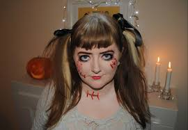 i dressed up as a scary doll which was actually a really costume to put together i wore a cream dress that i already owned and bought black ribbon