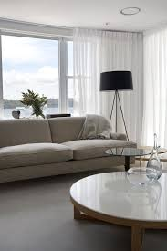 all white furnished spacious livng room remodeling ideas with low marble on top round table