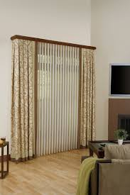 cool fabric vertical blinds decor with arm chairs and fireplace also wooden floor for family room