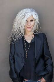 fine curly long hairstyle for women over 60