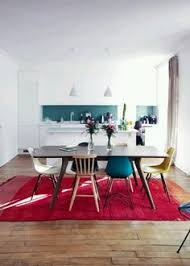 mismatched chairs with eames s chairs idea for game table in living room
