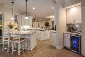 kitchen peninsula with seating on both sides pendant light with double cylinder glass shade island design light wood furnishings wonderful nautical theme