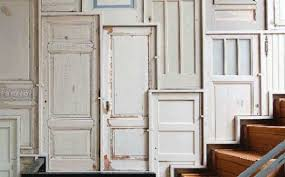 home decorating with old wood doors help tie your wall decor with wood furniture and give your modern interior design a stylish professional