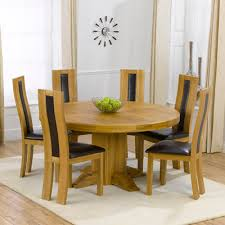 trina solid oak round dining table with 6 howard chairs 4267