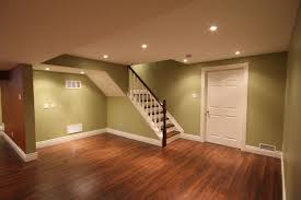 Appealing Basement Flooring Ideas And Modern Railling With Round Downlights
