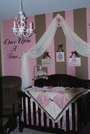 Design Dazzle: Pink & Brown Baby Nurseries ---- I like the initial holding  the fabric!