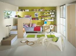 awesome kids bedroom with green wall paint two bed and wooden desk with white sleek floor tiles and white bench image